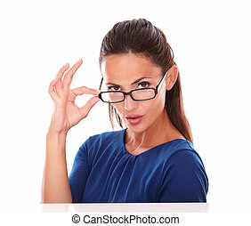 Charming lady with glasses looking at you