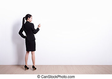 business woman writing - Back view of business woman writing...