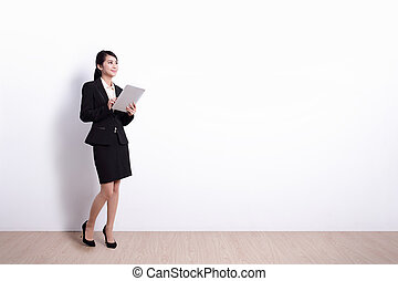 Business Woman with tablet pc - business woman using digital...