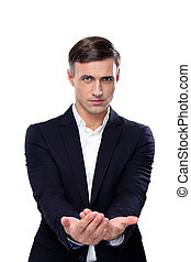 Handsome businessman asking for money on a white background