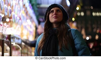 beautiful girl on the Christmas markets in Vienna looks...