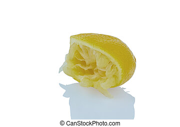 squeezed lemon - one of squeezed lemon on a white background...