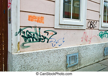 contaminated house wall - graffiti and inscriptions...