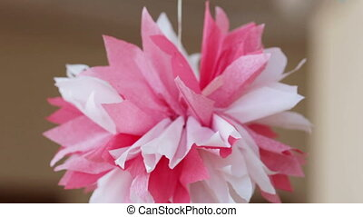 Paper flowers - Beautiful festive paper flowers hanging on...