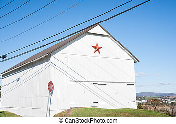 Mennonite star - Mennonite red star on end of white farm...