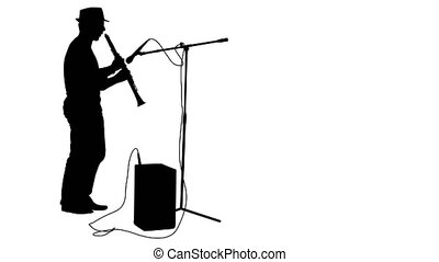 Silhouette musician plays the clarinet White screen footage...