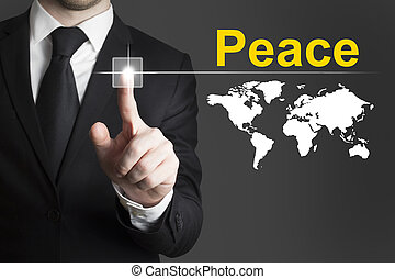 businessman pushing button peace world - businessman in...