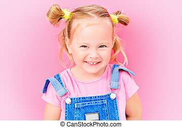 laughing child - Portrait of a cute little girl over bright...