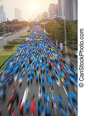 marathon runners on the street - SHENZHEN,CHINA - DECEMBER...