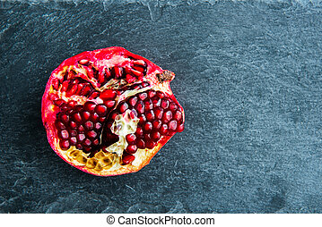 Closeup on pomegranate on stone substrate