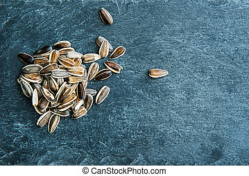 Sunflower seeds on stone substrate