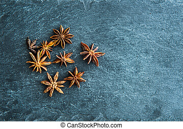 Closeup on star anise on stone substrate