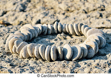 Ellipse - Sequence of small stones laid out in the form of a...