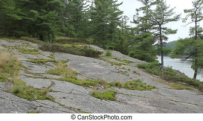 Rocky shore of Canadian river - Rocky shore of the French...