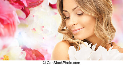 beautiful young woman with flowers - beauty, people and...