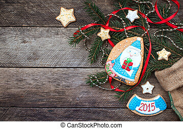 Christmas Santa in blue and New Year star cookies in rustic...
