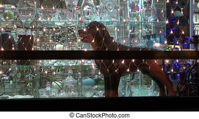 Christmas New Year shop window with light decoration and dog...