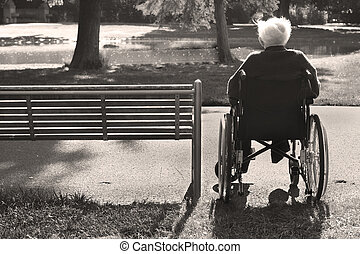 Old Age - Lonely elderly man sitting in a wheelchair next to...