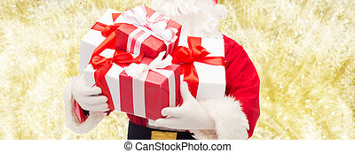 close up of santa claus with gift box - christmas, holidays...