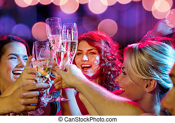smiling friends with glasses of champagne in club - party,...