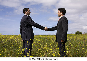 Business Deal - two businessman making a deal with a...