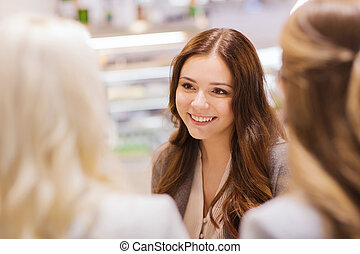 smiling young women meeting and talking - communication,...