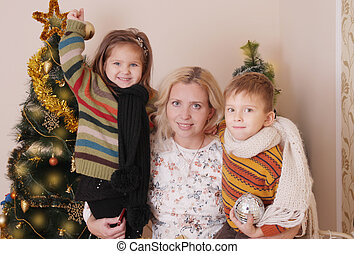 Mother and two children having fun at Christmas time