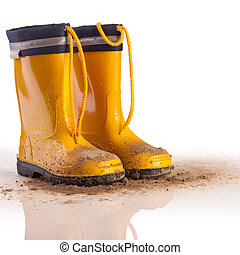 Yellow rubber boots for kids on white background - Yellow...