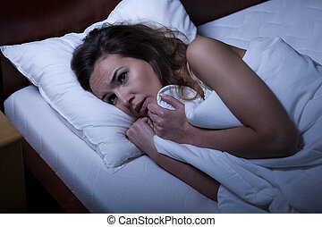Scared woman trying to sleep - Image of scared woman trying...