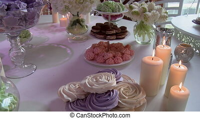Dessert table richly decorated with flowers - View of...