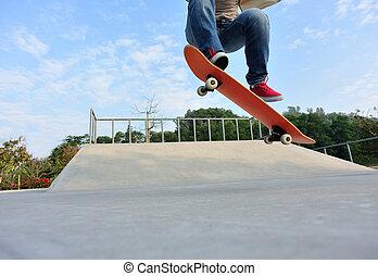 skateboarding at skatepark - skateboarder skateboarding at...