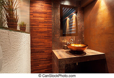 Expensive bathroom with golden sink