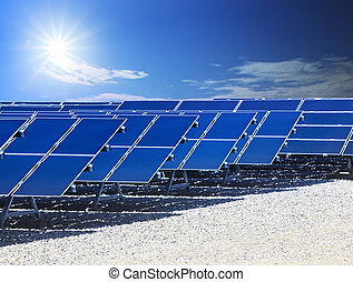 farm of solarcell panel and sun energy power shining on blue...