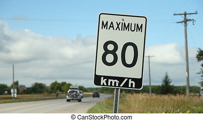 Maximum 80 kmhr SUV and pickup - Traffic passing a maximum...