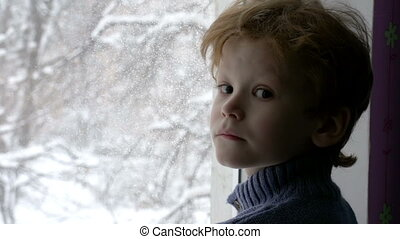 Christmas is Coming - Cute redhead boy looks at the camera...