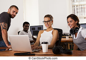 Team of entrepreneurs in a startup office - Team of young...