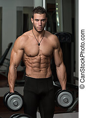 Healthy Young Man Doing Exercise For Biceps - Fit Athlete...