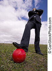 The power of soccer game - businessman holding a soccer ball...