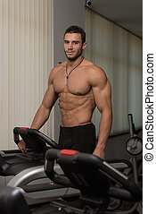 Man Jogging In A Gym - Man Running On Treadmill At A Health...
