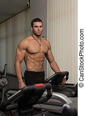Running On Treadmill - Man Running On Treadmill At A Health...