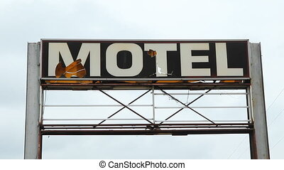 Broken Motel sign. - Large, broken motel sign. Sound of...