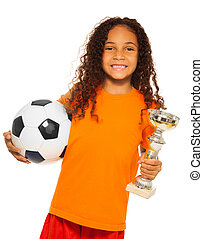 Little black girl holding soccer ball and prize - Close...