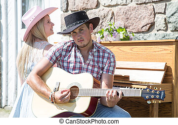 Outdoor Contry music couple - A young couple outdoors on a...