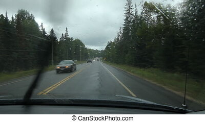 Rainy drive in Muskoka. Traffic.
