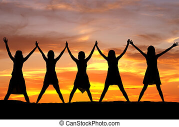 Cheerful women - Happy celebrating women at sunset or...