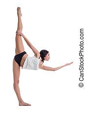 Attractive brunette doing vertical split