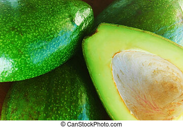 group of greeen bright cutted avocados