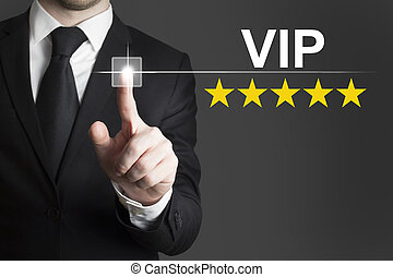 businessman pushing button vip five stars - businessman in...