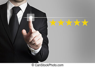 businessman pushing button five star rating - businessman in...