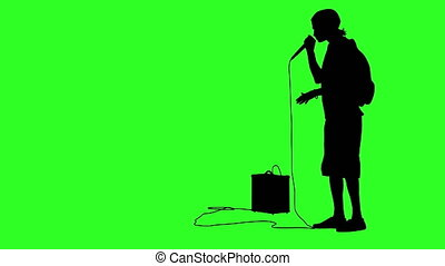 Silhouette of the guy beatbox with a microphone. Green...